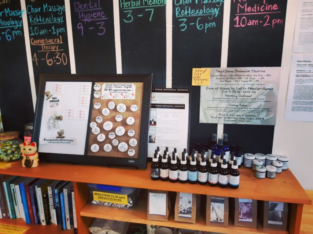 Lobby retail set-up with buttons, stickers, tinctures and salves
