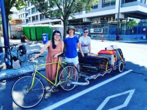 Christina Chan, Susan Shields and Heart & Hands volunteer, Jayne Hemming about to unload our 8 ft bike trailer from Recyclistas Bike Shop for Car Free Day, 2018