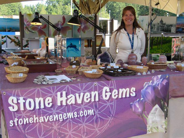 Christine Patton standing behind her gemstone display