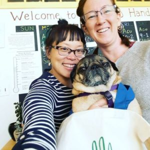 Christina, Melissa & Meatball showing off a H&H totebag in the lobby.