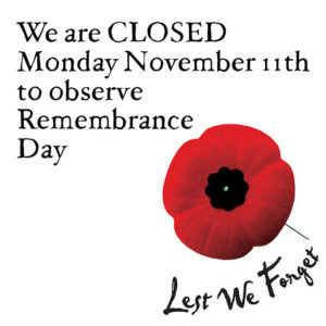 Remembrance Day 2019 with a red poppy and Lest we forget