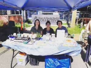 Rebecca Singer, Christina CHan, Susan Shields sitting at their table at the Village Block Party