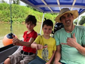 David in a boat with his 2 sons