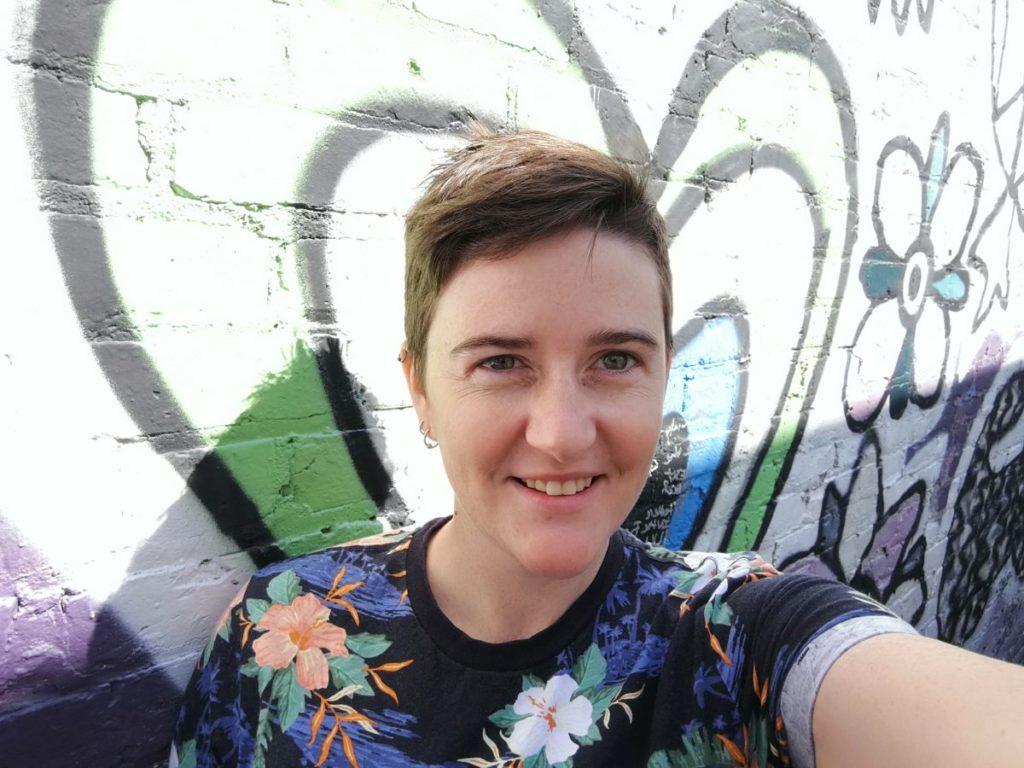 Katie has taken a selfie in front of our mural