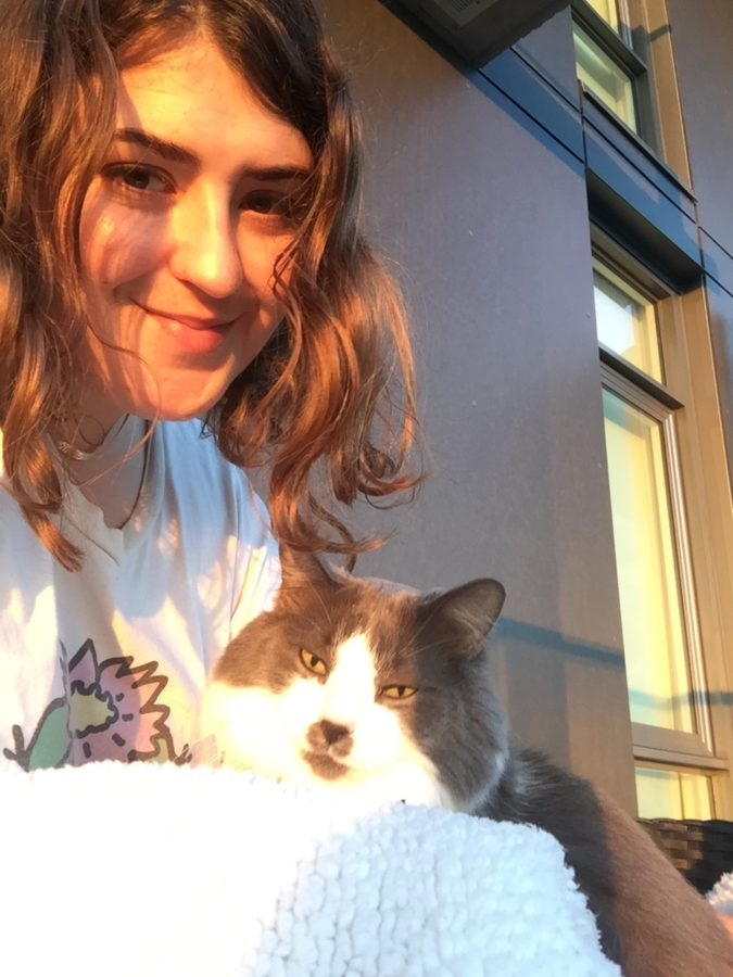 Allison and her cat, Arthur in the sun