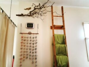 Our paper crane mobile, curly hazelnut and ladder with green fleece blankets.