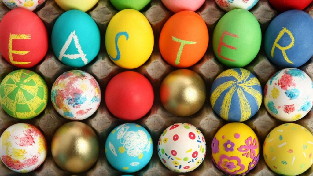 Colourful, painted Easter eggs in an egg carton